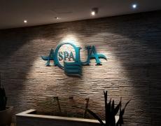 AquaSpa Sign on Stone Wall